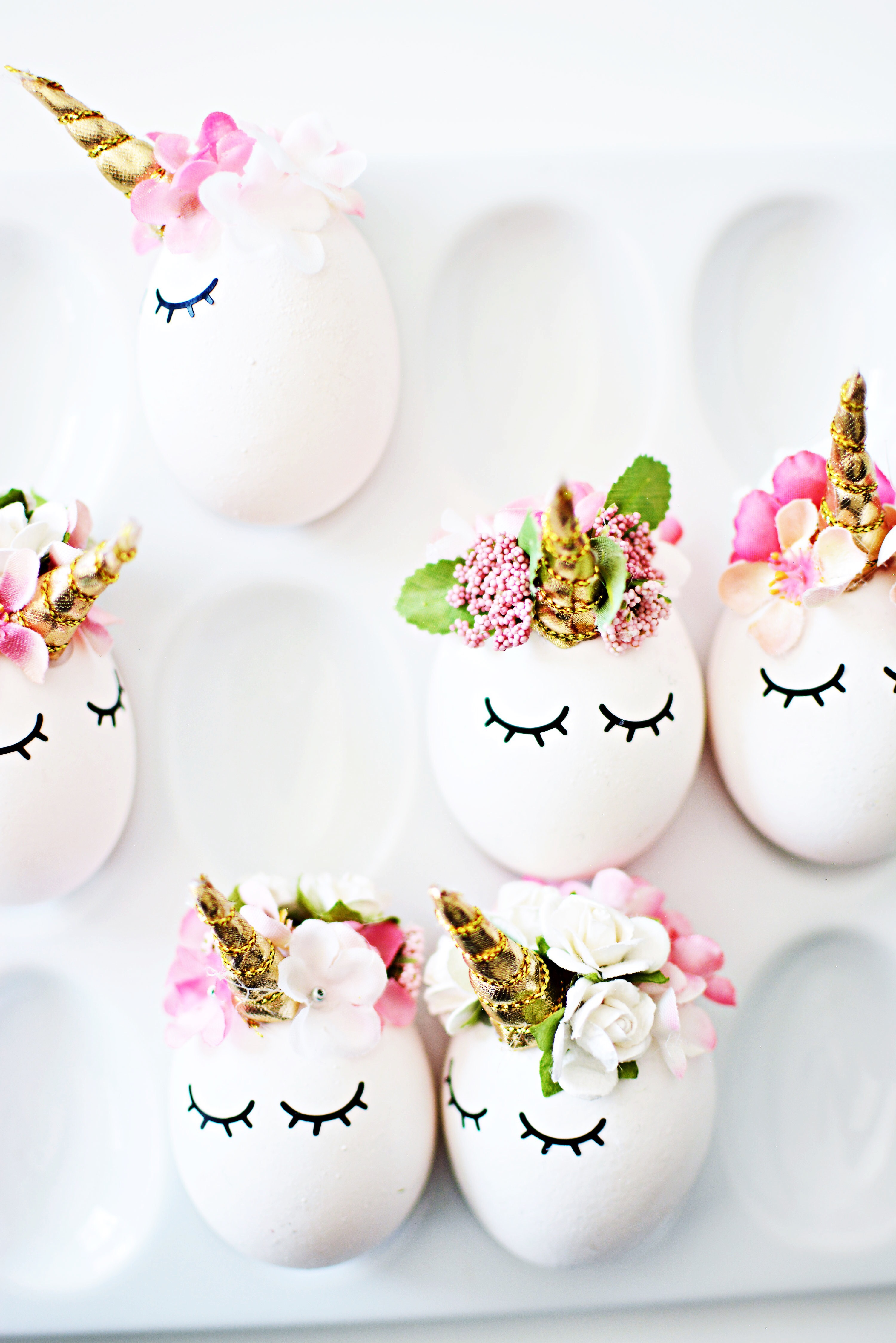 Diy unicorn easter eggs little inspiration a little hot glue some flowers and a few vinyl sleepy eyes later you have these irresistibly cute easter eggs any unicorn fanatic will love solutioingenieria Gallery