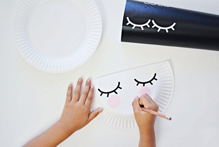 We used some vinyl eyes we created using Cricut Air 2. Cut out two small circles out light pink paper to form the cheeks and glue them just below the eyes. & Kid Craft: Paper Plate Purse » Little Inspiration